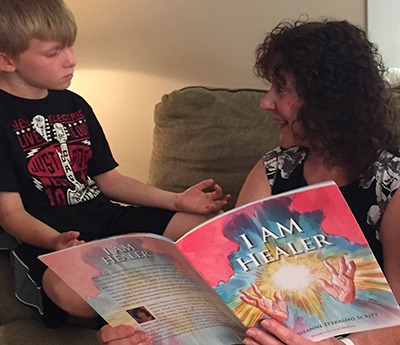 Roseanne D'Erasmo Reads her book I AM Healer to child learning meditation